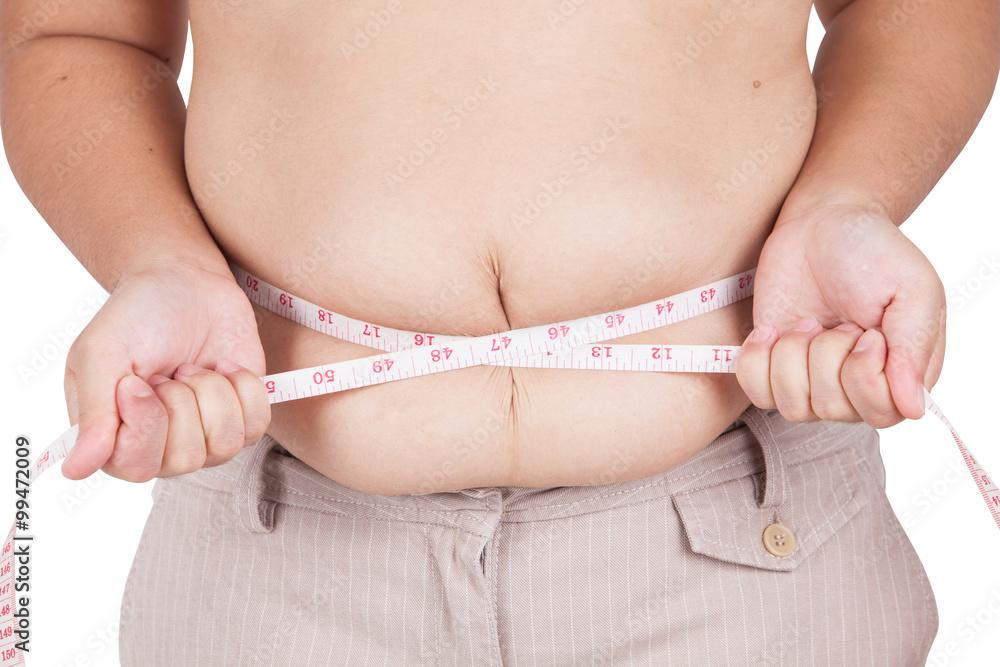 Fotografia, Obraz  fat woman measuring her stomach on white background
