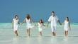Happy Caucasian family enjoying a beach vacation