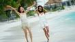 Beautiful African American Asian Chinese girls enjoying ocean beach