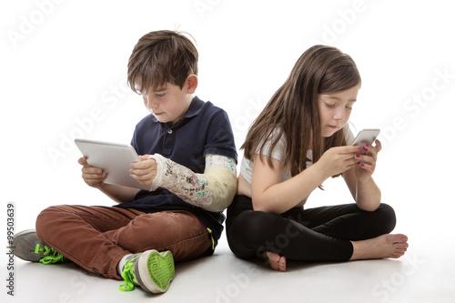 Fotografia, Obraz  children engrossed in technology
