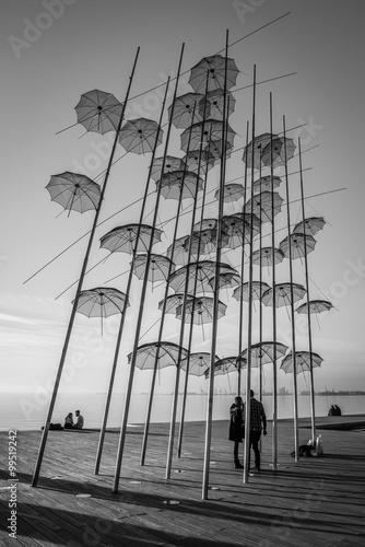 Obraz na plátně Black and white umbrellas of Thesseloniki, Greece