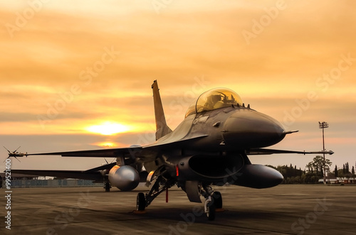 obraz dibond f16 falcon fighter jet on sunset background