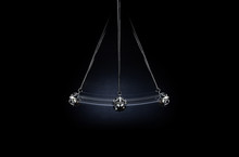 Hypnosis. A Silver Pendulum Swings On A Dark Background And Symbolizes The Hypnosis.