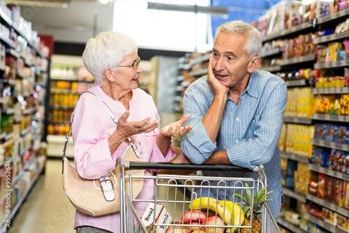 Plakat Starszy para razem zakupy