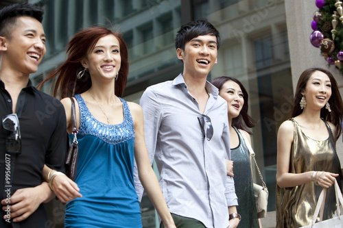 Excited young people go shopping on the street of Hong Kong Poster