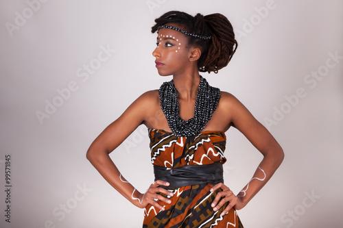 fototapeta na lodówkę Young beautiful african woman wearing traditional clothes