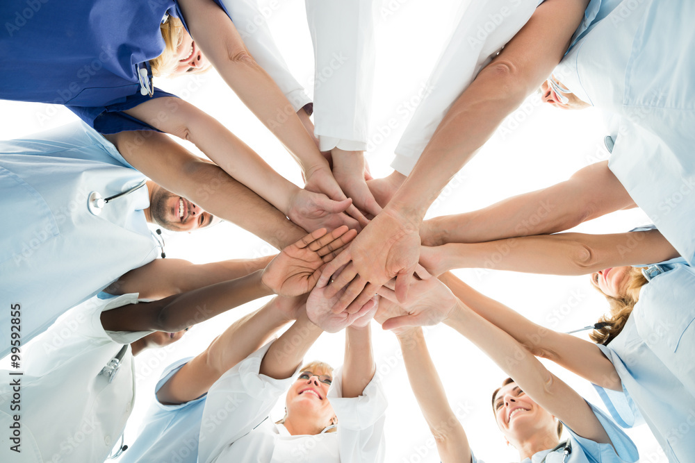 Fototapeta Multiethnic Medical Team Stacking Hands