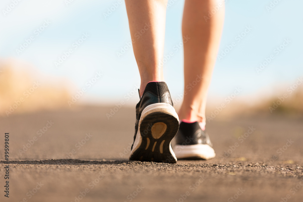 Fototapety, obrazy: Woman walking on a path. (Fitness concept)