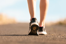 Woman Walking On A Path. (Fitness Concept)