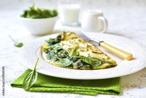Omelette stuffed with spinach and cheese.