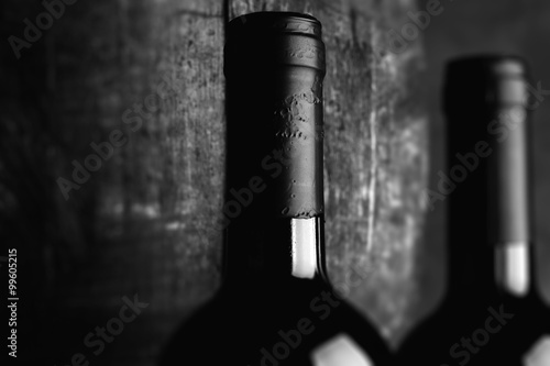 Photo  red wine bottle - tilt shift selective focus effect black and white photo