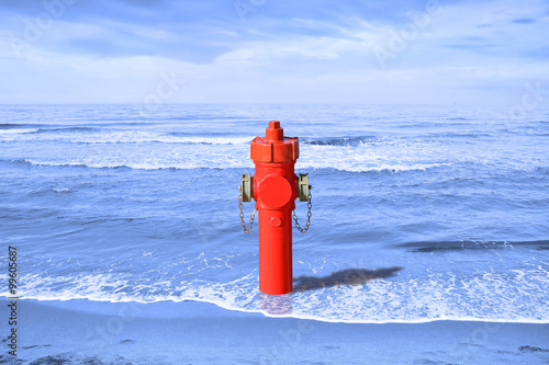 A hydrant at the seaside. Plenty of water: concept image Canvas Print