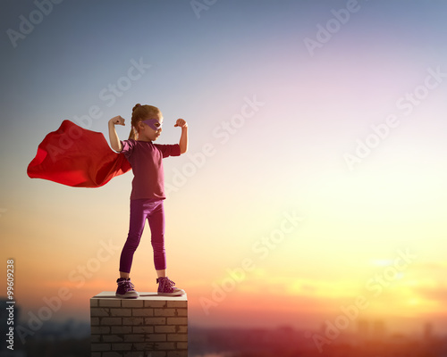 Fototapeta girl plays superhero obraz