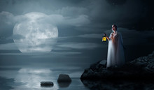 Elven Girl With Lantern On Night Sea Coast