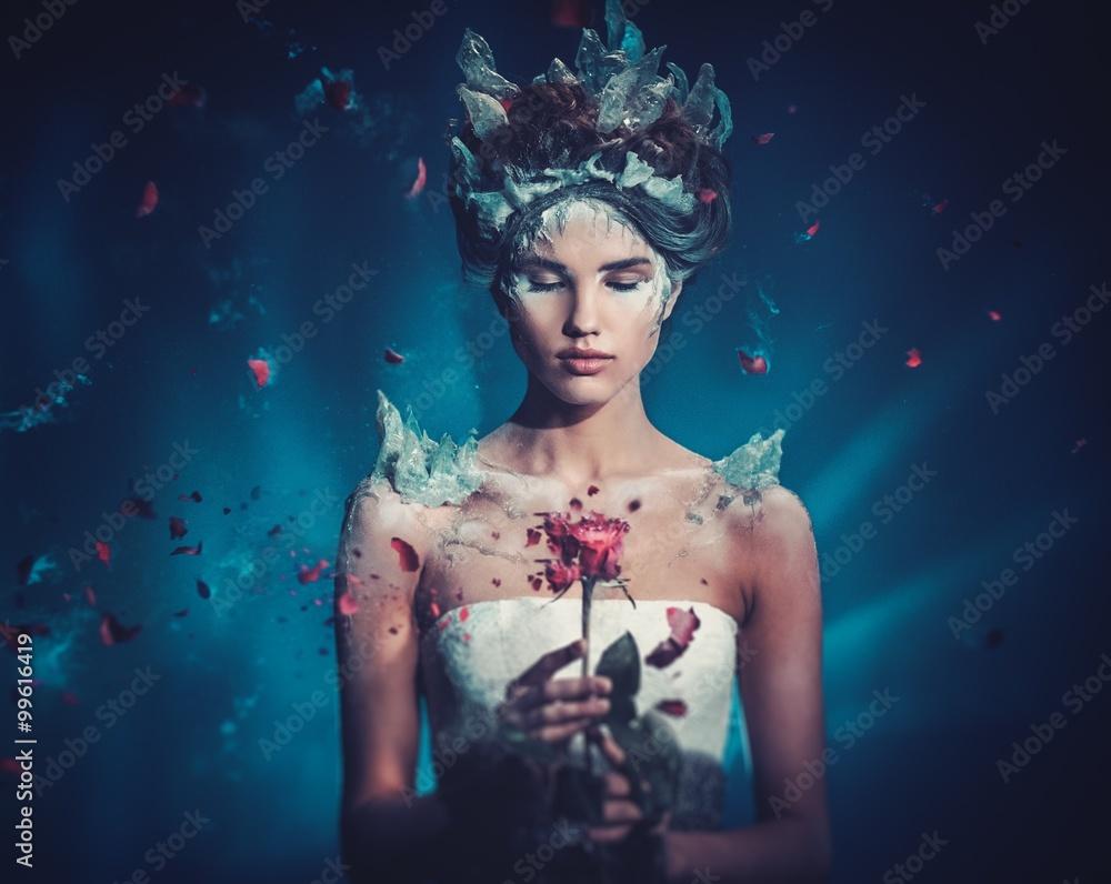 Fototapeta Winter beauty fantasy woman portrait. Beautiful young model girl and blast of frozen rose.