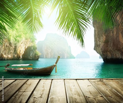 Deurstickers Tropical strand Adaman sea and wooden boat in Thailand