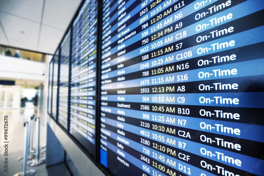 Fototapeta info of flight on billboard in airport