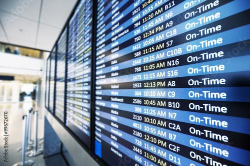 info of flight on billboard in airport Canvas