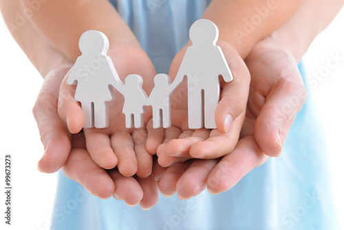 Photo Concept of united family - figures of parents and kids in girls and mothers hand