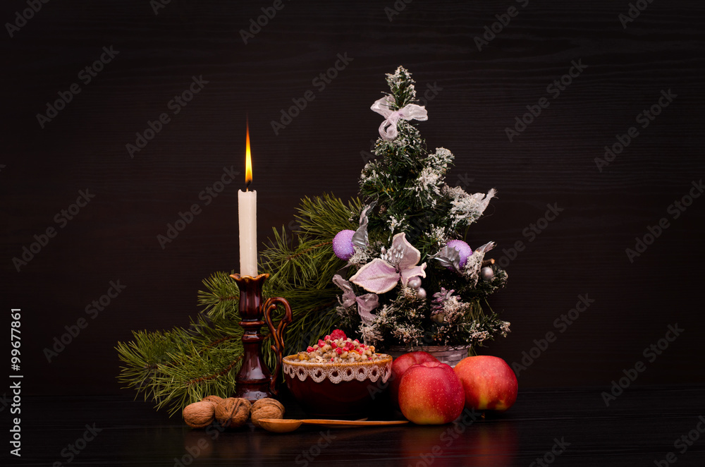 Fototapety, obrazy: Christmas kutia Traditional Slavic sweet dish. Candle, apples and Christmas tree on a black background