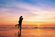 Couple Kissing On The Beach Wi...