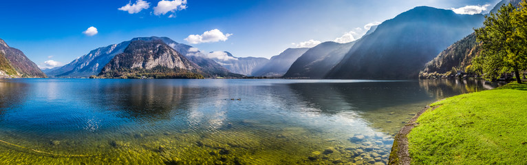 Fototapeta Panorama of crystal clear mountain lake in Alps
