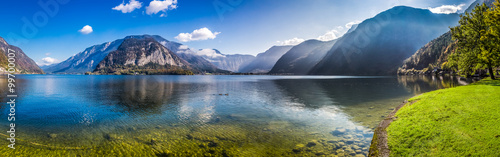 Fototapeten Alpen Panorama of crystal clear mountain lake in Alps