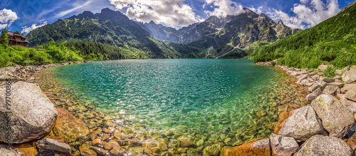 Tuinposter Zalm Panorama of lake in the middle of the Tatra mountains at dawn