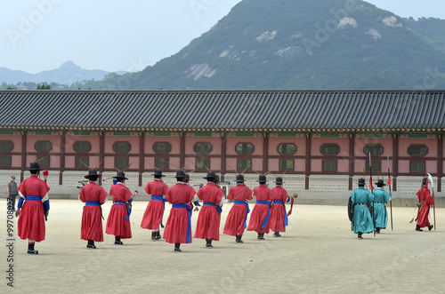 Row of armed guards in ancient traditional soldier uniforms in the old royal residence, Seoul, South Korea..