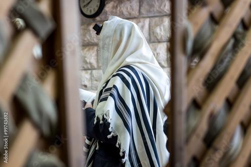 Fototapeta Jewish men praying in a synagogue with Tallit  obraz