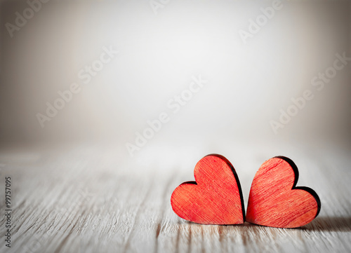Obraz Valentines day background with two red hearts on wooden background - fototapety do salonu
