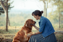 Beautiful Woman With A Cute Golden Retriever Dog