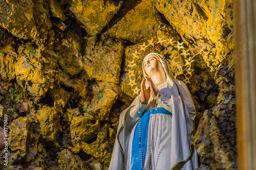 Printed kitchen splashbacks Historical buildings the Blessed Virgin Mary in the grotto at Lourdes