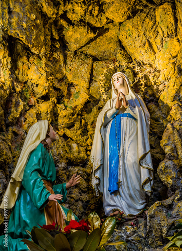 the Blessed Virgin Mary in the grotto at Lourdes Canvas Print