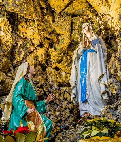 the Blessed Virgin Mary in the grotto at Lourdes Wallpaper Mural