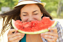 Happy Young Woman Eating Watermelon On The Beach. Youth Lifestyl