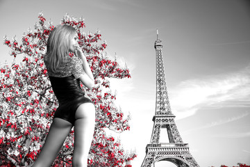 girl in a body on the background of the Eiffel Tower