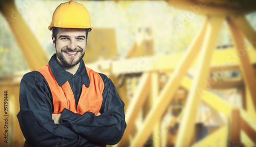Fotografia  smiling worker in protective uniform and protective helmet