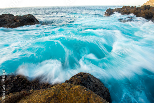 Photographie  Seascape view on rocky coast with waves