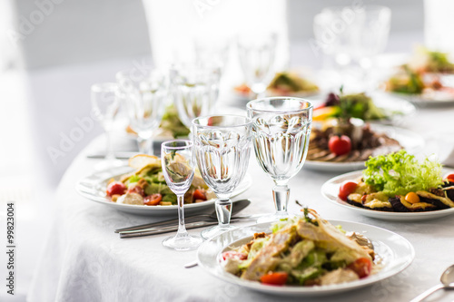 Empty glasses  in restaurant. Banquet table set Fototapeta