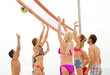Group of people playing beachvolley