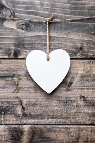 Love concept. Heart hanging on a string