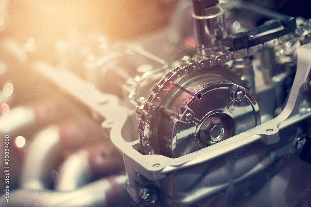 Fototapeta Chain in cut metal car engine part