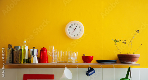 Photo  Yellow wall clock in the kitchen