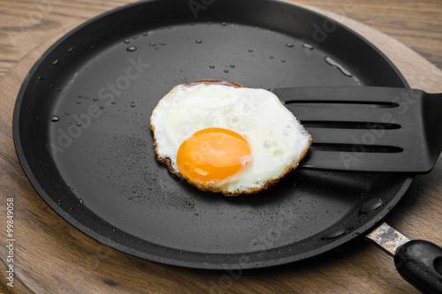 Deurstickers Gebakken Eieren Fried eggs on a pan