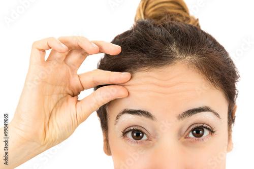 Fotografie, Obraz  Wrinkles on female forehead