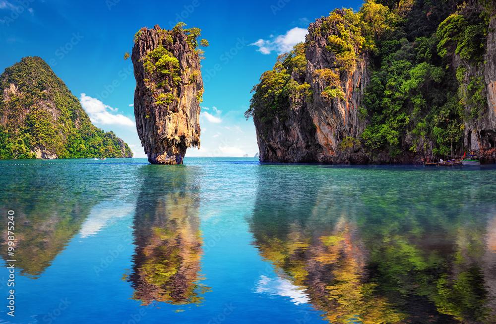 Fototapeta Beautiful nature of Thailand. James Bond island reflects in water near Phuket