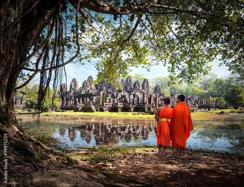 Buddhist monks near Angkor Wat temples in Cambodia Canvas Print