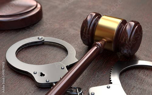 Fotografia, Obraz Gavel and handcuffs on wooden table background