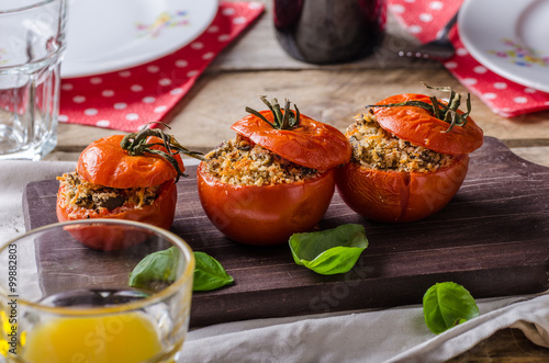 Fototapeta Baked tomatoes stuffed with herbs obraz